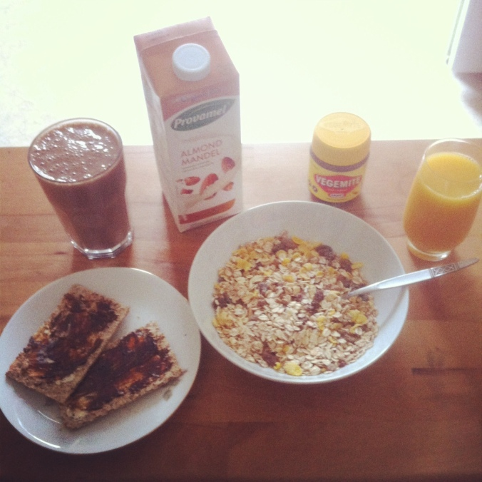 Breakfast. Green smoothie, muesli and hazelnut milk, orange juice, vegemite on rye biscuits.