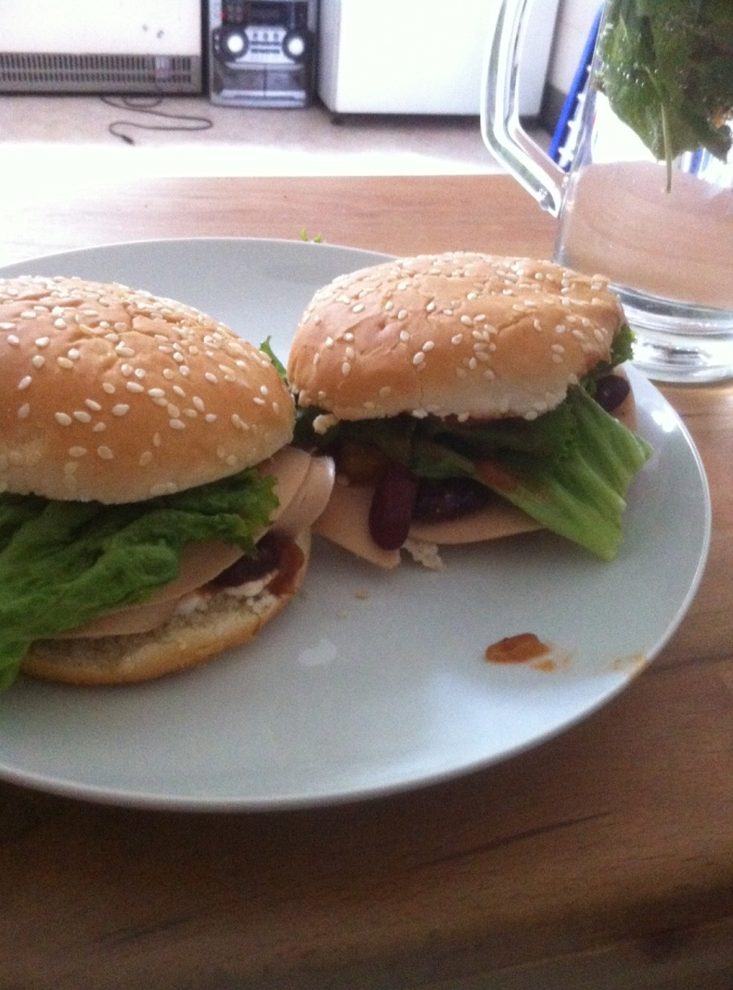 Burgers, vegan salami, beans, vegetables.